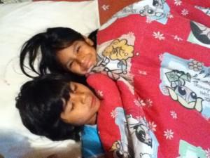 Alandra and Nohemi snuggling