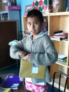Karina binding a notebook