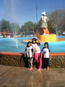 Alandra, Adriana, and Nohemi after jumping in the fountain.